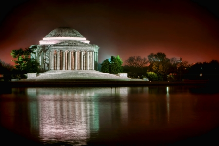 jefferson: Thomas Jefferson Memorial famous American landmark with light reflections on the water of the Tidal Basin in West Potomac Park at night in the capital of the United States of Washington DC