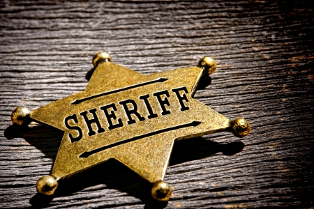 jailer: antique sheriff star shape gold color brass badge  Stock Photo