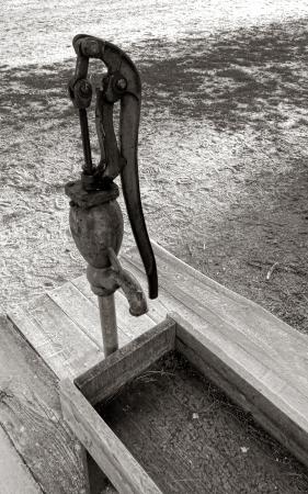 crank: Antique public water fountain cast iron hand crank rusty pump