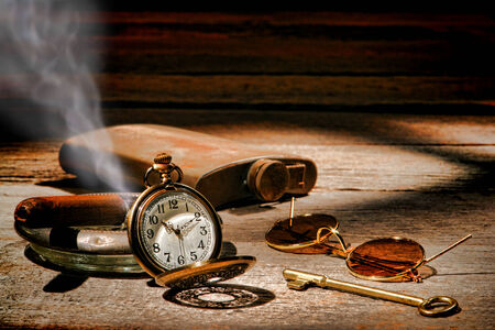 old items: American West Legend frontier traveler vintage travel items with antique pocket watch and smoking cigar