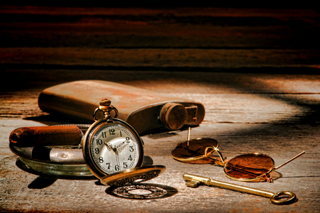 old items: American West Legend frontier traveler vintage travel items with antique pocket watch and cigar  Stock Photo