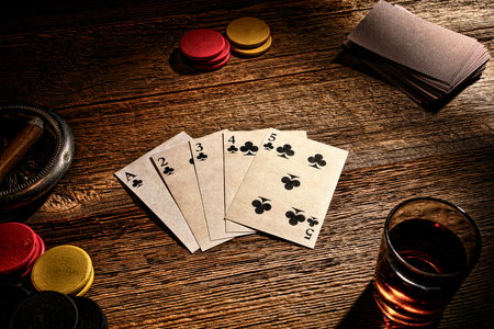 legend: American West legend old gambler poker game with vintage playing cards  Stock Photo