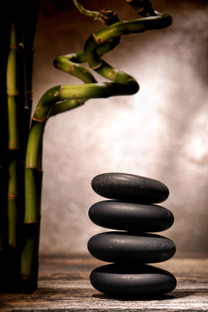 polished: Polished smooth black hot massage stones stack in a Zen inspiration cairn