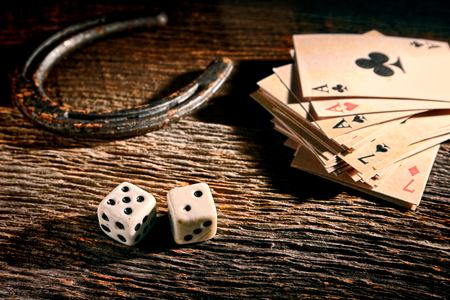 good luck charm: American West Legend lucky antique craps game dice rolling out  Stock Photo