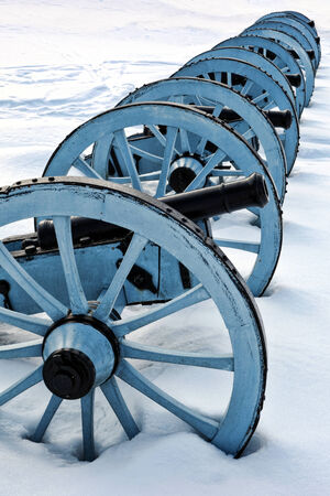 American Revolutionary War cannons battery in an artillery position in winter snow at Valley Forge National Historical Park military camp of the Continental Army near Philadelphia in Pennsylvania  photo