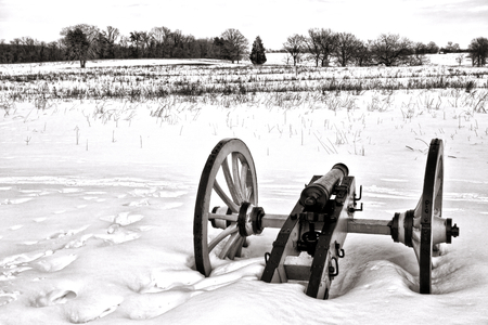 forge: American Revolutionary War lone cannon in a snow covered field in winter at Valley Forge National Historical Park military camp of the Continental Army near Philadelphia in Pennsylvania