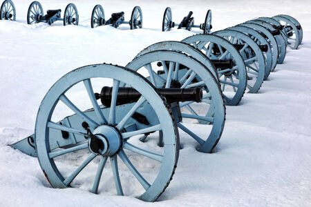 forge: American Revolutionary War cannons defense battery in a defensive artillery formation in winter snow at Valley Forge National Historical Park military camp of the Continental Army near Philadelphia in Pennsylvania
