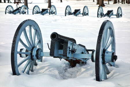 American Revolutionary War cannon and defense battery in a defensive artillery formation in winter snow at Valley Forge National Historical Park military camp of the Continental Army near Philadelphia in Pennsylvania