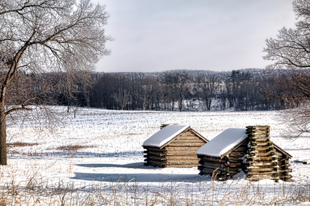 American Revolutionary War soldier housing wood cabins landscape in an encampment in winter snow at Valley Forge National Historical Park military camp of the Continental Army near Philadelphia in Pennsylvania