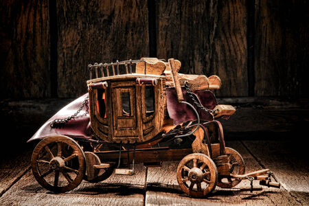 wells: Antique reproduction miniature western stagecoach wagon artisan made craft wood toy crafted by old West frontier native American Indian craftsman
