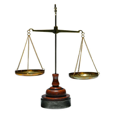 balance scale: Old antique brass balance type weight measuring scale with weighing trays and wood base isolated on white