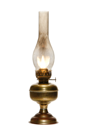 oil  lamp: Old antique kerosene oil lantern brass hurricane lamp with hot burning flame casting light in a vintage glass chimney over fuel container metal base isolated on white