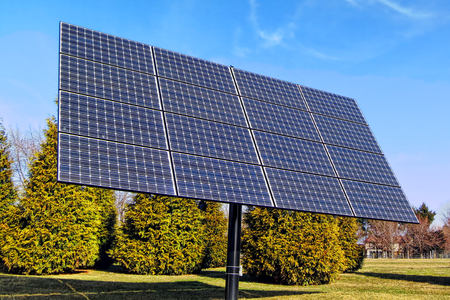 solar array: Renewable clean green electric energy generating efficient photovoltaic solar panels array on a mounting pole in an industrial installation application