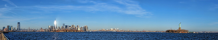 New York City Downtown Lower Manhattan skyline cityscape wide panorama with newest One World Trade Center Freedom Tower and wall street area including Statue of Liberty and Ellis Island on the Hudson River waterfront viewed from Jersey photo