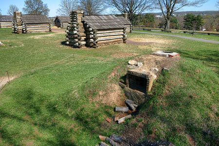 forge: Outdoor kitchen cooking and bake oven with firewood logs at the Valley Forge National Historical Park encampment of American  Stock Photo