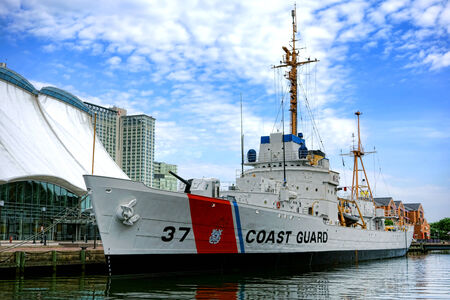 Historical USCGC US Coast Guard high endurance cutter Taney WHEC-37 moored as a museum ship and National Historic Landmark on Pier Three at the Inner Harbor in Baltimore Maryland