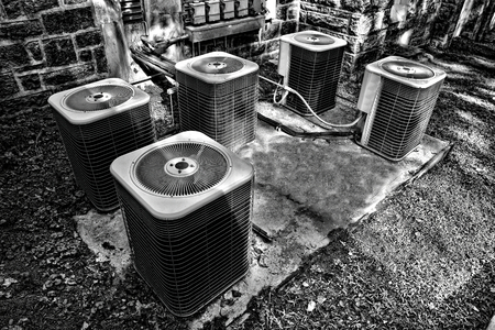 HVAC air conditioner condenser fan units in a combined battery set for a commercial application of climate control cooling and refrigeration AC conditioning temperature system