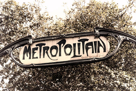 Paris Metropolitain old Metro subway station entrance overhead enamel vintage sign crafted in Art Nouveau style designed by French architect Hector Guimard in France