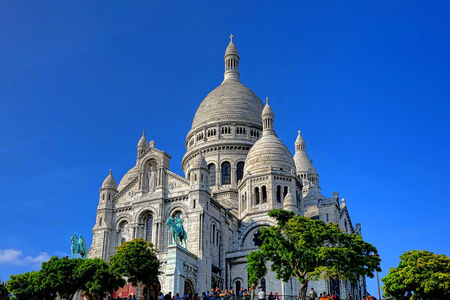 The Sacre Coeur Basilica of the Sacred Heart of Paris tourist landmark Roman Catholic church at the summit of the Parisian tourist attraction Butte Montmartre in France