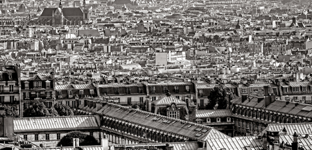Old French buildings and Parisian city houses roofs and rooftops in the capital of France in Paris aerial view from above Editorial