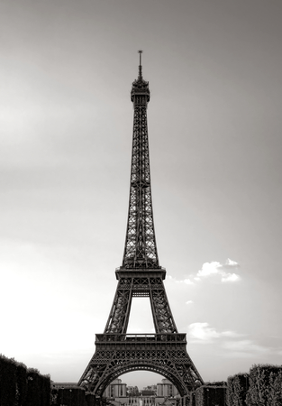 The Eiffel Tower landmark classic majestic view from the Champ de Mars esplanade in Paris France in nostalgic toned black and white Editorial