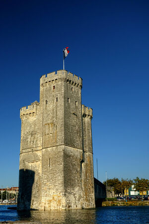 Saint Nicolas medieval fortress tower at the fortified entrance of the old port harbor in the French city of La Rochelle in France