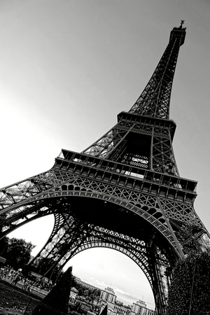 The Eiffel Tower landmark classic majestic view from the Champ de Mars esplanade below in Paris France in dramatic artistic black and white Imagens