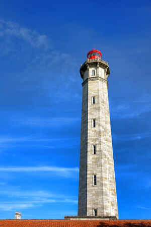 Grand Phare des Baleines maritime navigation lighthouse tower on the French Ile de Re island on the Bay of Biscay in France Imagens