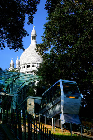 inclined: Montmartre funicular inclined railway riding up the famous Butte below the Sacre Coeur basilica monument and carrying tourism visitors uphill in Paris France