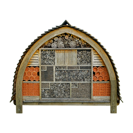 beneficial insect: Bee hotel garden insect wood house nesting and beehive housing box built of wood and natural components to attract and protect the beneficial organic cultivation insect isolated on white
