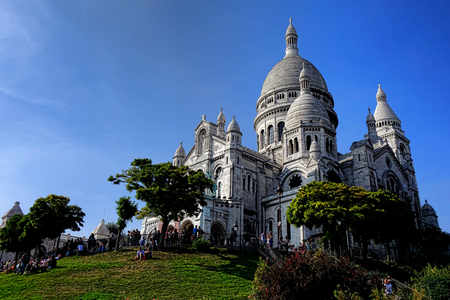 Sacre Coeur Basilica of the Sacred Heart Roman Catholic church at the top of the Butte Montmartre and a major Parisian tourist attraction in Paris France