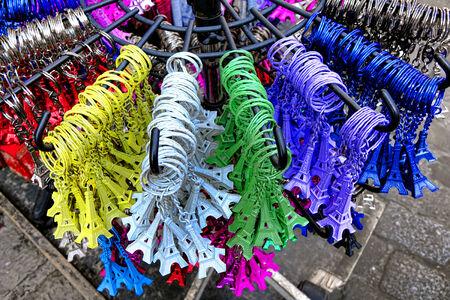 Assorted colors miniature Eiffel Tower key chain trinkets pendants for sale as tourism souvenir on a tourist shop display in Paris France Stock Photo - 34560924