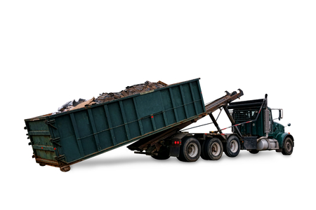 dump truck: Roll off utility truck loading a refuse garbage  open top container full of construction trash for waste disposal hauling and recycling isolated on white Stock Photo