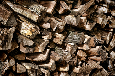 Old fashioned cut wood logs stack pile waiting in reserve for burning as fuel heat firewood Imagens