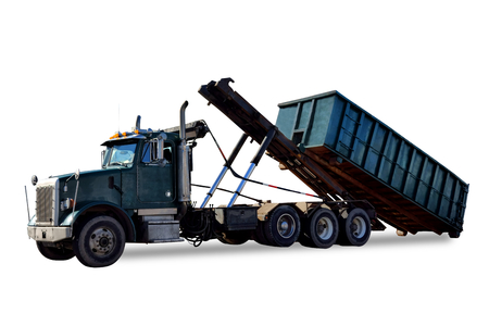 Roll off utility truck unloading an empty refuse garbage dumpster open top container for construction waste disposal hauling and recycling isolated on white