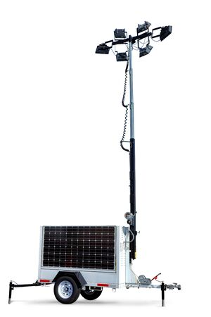 Solar power portable electric light tower mobile trailer with LED lighting lamps above telescoping mast and photovoltaic power generation panel over white