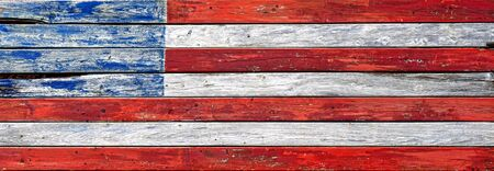 Distressed antique wood plank boards modified design United Sates of America Old Glory American flag representation on a vintage wooden wall Imagens