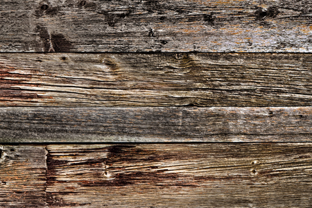 Antique and weathered barn wood old plank boards rustic barnwood with rough vintage grain texture background