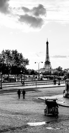 Eiffel Tower and people walking and cycling