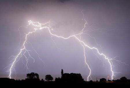 Lightning is a naturally occurring electrostatic discharge during which two electrically charged regions in the atmosphere or ground temporarily equalize themselves.