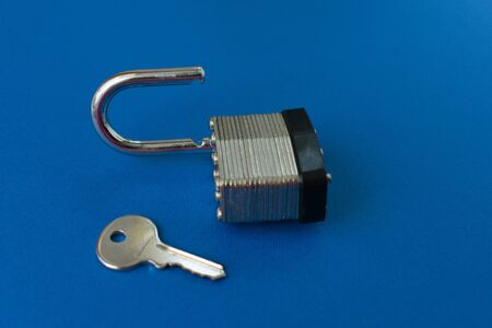 Lock with key on blue background