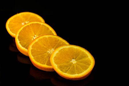 Orange sliced ??on black background Banco de Imagens