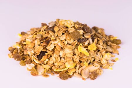 A pile of granola on a white background. Useful food. Imagens