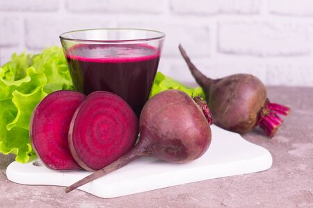 Fresh healthy beet juice in a glass on a white background.