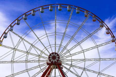 Big Ferris wheel against the blue sky.