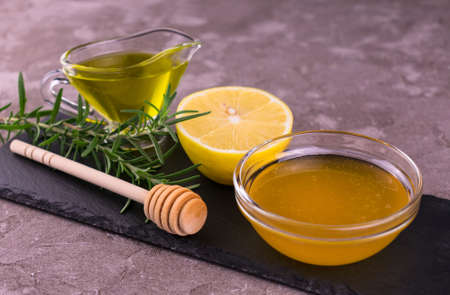Rosemary, honey, lemon and olive oil. Spices and dressings for the sauce. Stock fotó