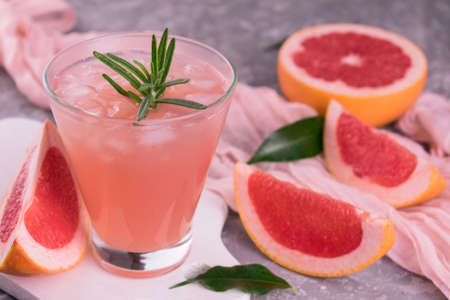 Grapefruit drink with ice. Close-up.