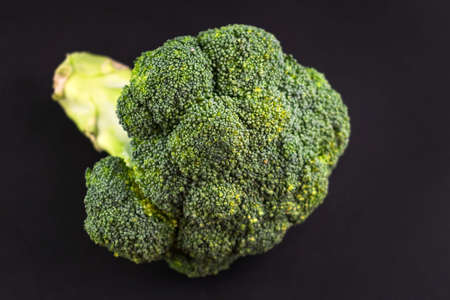 Broccoli cabbage on a black background. Close-up.
