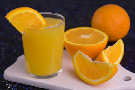 A glass of fresh orange juice. Close-up.