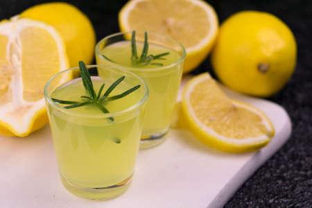 Sicilian lemon liqueur limoncello with rosemary branch. Stock fotó